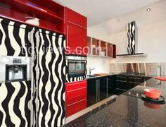 Love the red cabinets but zebra print in the kitchen...not so sure. I am sure that this is not a good idea for my mother's kitchen!
