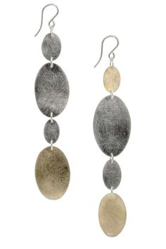When selecting jewelry pieces I like to choose items that can go with everything like this teardrop mixed metal earring Riverstone Earrings, $140
