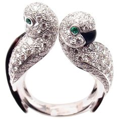 "CARTIER ""Les Oiseaux Libérés"" Diamond Emerald Onyx 18k White Gold Ring with round brilliant-cut Diamonds VVS1 clarity, E color 2 round Emeralds in the eyes 2 Black Onyx beaks .This ring comes with Cartier service paper from Cartier store in NYC and a Cartier box. YOUR PRICE: $45,000 Cartier Current Retail Price: $52,500 (plus tax)"