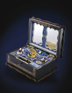 FRENCH, A SINGING BIRD NECESSAIRE COMPENDIUM IN AN INLAID EBONISED CASE CIRCA 1870