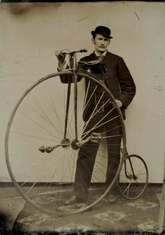 Tintype portrait of a cyclist with high wheeled bicycle, ca. 1870