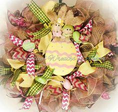 Easter Bunny wreath, door wreath, door hanger. Jute mesh, colored eggs, ribbons and a large metal egg centerpiece.