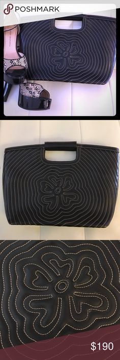 Mario Hernandez clutch Mario Hernandez clutch purse. Very detailed design stitched on the front. Sleek looking design. Has a removable zippered pouch inside(can be used for make-up storage) Mario Hernandez Bags Clutches & Wristlets
