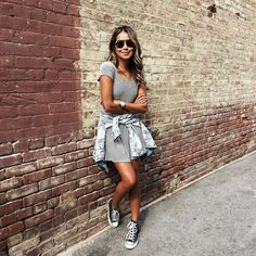 Pin for Later: Jean Jacket Outfit Inspiration that Will Take You from Summer to Fall Around Your Waist With Converse