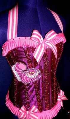 I so want this...2 of my loves, Disney Cheshire Cats & corsets :)