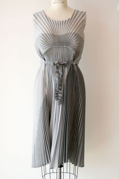 Pleated dress with structured pleat patterns - fabric manipulation; sewing; fashion design detail // Issey Miyake