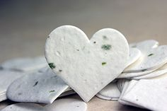 "These gorgeous 1.75"" x 1.5"" seed paper heart shapes have been die-cut from handmade paper stock. Perfect for favors, favor tags, table confetti, bridal showers, add on to invitations...They are eco-friendly and have 10 species of annual and perennial wildflower seeds embedded so they will sprout into a garden of flowers if planted and cared for. Perfect for any wedding theme or celebration. They are sold in sets of 50 and ship right away. The paper is made from 100% tree free cotton fibers."