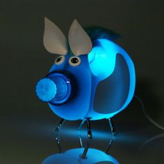 I saw this on Fab.com for over a hundred dollars but, I'm thinking you could recreate this easily and much cheaper on your own. It's made from an upcycled detergent bottle, screws (legs, I think), button eyes, and is wired with a standard nightlight style socket with switch-in-cord and standard wall outlet plug. It didn't say what the other materials are, but it looks like foam sheet ears & colorful faux hair. Would be cute for kids' rooms w/ many bottle, color, & creature options!