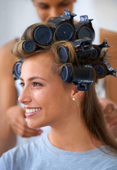 How to use hot rollers. Model with rollers in her hair with stylist.