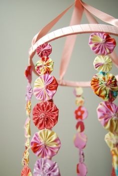 Beautiful flower mobile - finally something to do with that big basket of those flowers I have been making.