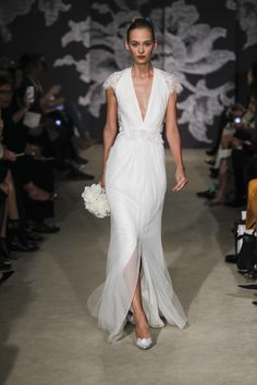 A dramatic, plunging V-Neck and front slit distinguish this sexy Carolina Herrera gown {photo: Dan Lecca}