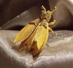 Vintage Hattie Carnegie Trembler Bug Brooch by TheEclecticDiva on Etsy https://www.etsy.com/listing/164110702/vintage-hattie-carnegie-trembler-bug