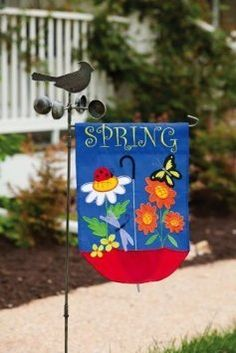 "Spring Flag - Spring Showers Garden Flag by Evergreen Enterprises, Inc.. $15.97. Great for yourself or as a gift. Perfect springtime flag. Made of high-quality nylon; weather-resistant. Applique Flag; double-sided. 18""L x 12.5""W. Celebrate springtime with our lovely Spring Showers Garden Flag. This colorful flag displays a dragonfly, butterfly, and ladybug enjoying their flowering friends atop an upside-down umbrella. This flag is double-sided, so you will be able to read ""Spr..."
