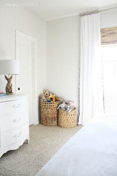 Crazy Wonderful: girl's bedroom, neutral girl's room, black and white girl's bedroom, pom pom curtains, white french dresser, Emily & Meritt bunny lamp, stuffed animal basket storage
