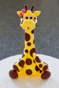 So cute for a baby shower! Goofy Little Giraffe Cake Topper. $15.00, via Etsy.