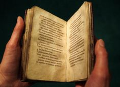 Europe's oldest book: St Cuthbert's gospel (AD698) which survived pillaging Vikings and lay in his coffin for centuries