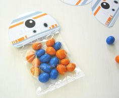 Click here to download FREE BB-8 treat bag labels! Give these out to all your guests at you child's Star Wars themed birthday party!