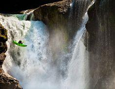 waterfall jump with kayak