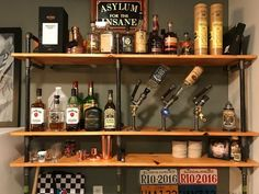 Bar with black iron pipe or galvenized steel pipe thick with stained wood shelves. Vodka, Antique Booth Ideas, Alcohol Dispenser, Bar Shelves, Home Bar Furniture, Iron Pipe, Wine Rack, Metal Working, Wood Projects