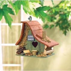 "Love Shack Birdhouse Garden Decor - The heart-shaped door gives it away: This is a little ""Love Shack!"" The amusing asymmetrical architecture of this little Love Shack Birdhouse Garden Decor is trimmed with several various forest treasures."