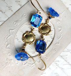Sapphire Swarovski statement earrings, blue dangle crystal flower earrings, sacred cake earrings, long gold and blue earrings. Amethyst Earrings, Blue Earrings, Flower Earrings, Statement Earrings, Star Earrings, Rhinestone Earrings, Bridal Necklace, Crystal Necklace, Edwardian Jewelry