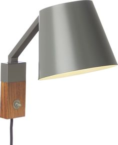 Clean and contemporary, our Jax sconce adds serious style next to the bed or framing the entryway. Tapered grey steel shade angles on a fixed arm to a two-tone base of grey steel warmed by walnut with a prominent switch. Modern Family, Mid-century Modern, Contemporary, Over The Desk, House Games, Hallway Lighting, Walnut Veneer, Bedside Lamp, Nightstands