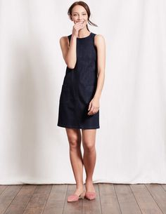Meet our not-so-simple pinafore dress. We've designed it in cotton denim with a little stretch for extra comfort, and stitching details for an authentic feel. The panelling and grosgrain ribbon details make it smart enough for the office, while the two patch pockets keep that weekend feeling right through to Monday.