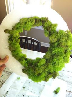 How to make a moss wreath for a table centerpiece or door. Supply List: 2 bags of reindeer moss, hot glue gun and three glue sticks, foam wreath ring, Ribbon