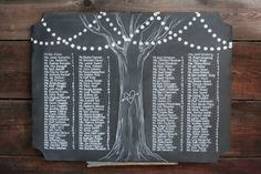 Tree with lights seating chart with heart and initial detail. Custom chalk seating. escort board.