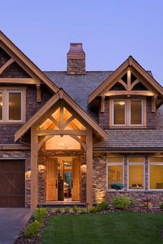 The outside of the house incorporates a variety of richly textured materials, including cultured stone veneer, treated cedar shingles and timber-framed elements. Although it looks compact from the front, the house offers more than 5,500 square feet of living space.