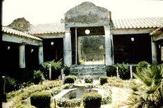 Pompeii ~ Casa degli Amorini Dorati or House of the Golden Cupids or Domus Cn. Poppaei Habiti or House of Gnaeus Poppaeus Habitus ~ Excavated 1903-5 ~  Looking west across garden area towards large triclinium, a formal dining area in a Roman home. 1957