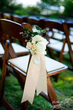 Ivory rose and ribbon pew arrangement