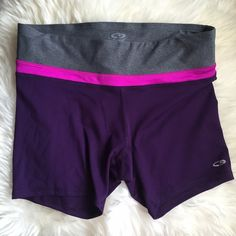 "Champion Purple & Gray Spandex Shorts Excellent condition! Polyester/spandex mix, soft and lightweight. Dark purple with a grey waistband. Waist measures 14"", length on sides is 12"" ❌NO TRADES OR PAYPAL❌ Champion Shorts"