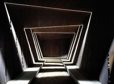 Illuminated, exterior glass slots create a repetitive pattern in walkway.  Bell Lloc Winery by RCR Architects
