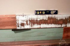 how to install a scrap wood wall, diy, home decor, pallet, wall decor, woodworking projects, Place the board onto the wall Check and make adjustments to level the board Add a shim if you need to keep the board leveled