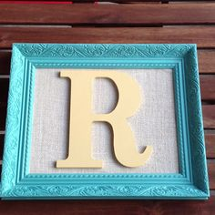 Upcycled frame and letter from hobby lobby.
