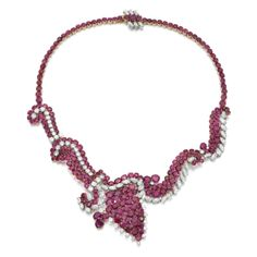 RUBY AND DIAMOND NECKLACE, 1950s  Designed as a series of stylised paisley motifs, set with variously shaped faceted rubies, marquise-shaped and brilliant-cut diamonds,length approximately 390mm, fitted case by Carl Ernst Wiesbaden.  RUBY AND DIAMOND NECKLACE, 1950s  Designed as a series of stylised paisley motifs, set with variously shaped faceted rubies, marquise-shaped and brilliant-cut diamonds,length approximately 390mm, fitted case by Carl Ernst Wiesbaden.