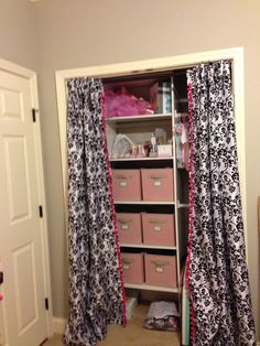 Closet Organizer with pink fabric baskets