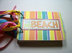 Beach Mini Album is made from chipboard coasters covered with pretty patterned paper and measures 5 1/4 x 3 3/4 inches. There are 10 premade pages