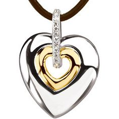 Your heart in his.  0.07 ct tw Diamond Heart 14ky Gold and Sterling Silver Necklace | $365