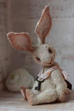 This is a firm favourite ~ Carolin By Anzhelika Costin - Artist teddy bunny Carolin aprox.15 cm.100% handmadeOriginal sewing patternUnique / Exclusive !Viscose, cotton Filled with washable cotton craft and the stahl granulesglass eyes are painted with oil Joint discs - head (2), arm...