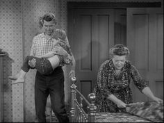 Andy & Aunt Bee putting an exhausted Opie to bed