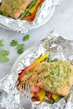 Topped with a green chile cilantro sauce, this Mexican Baked Salmon in Foil recipe is easy to make, takes 35 minutes from start to finish and is perfect for lunch and dinner.