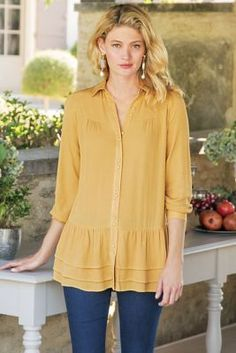 Cheers for three tiers - of ruffles, that is, falling lithely into place as a hemline finale to this crinkled gauze blouse. Its easy drape is tailored for flow, with shirring