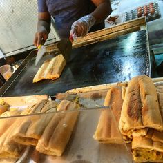 Roti John. You can find them at hawker centres and pasar malam (night markets). They are french bread coated with eggs and butter and chilli and mayonaise sauce.