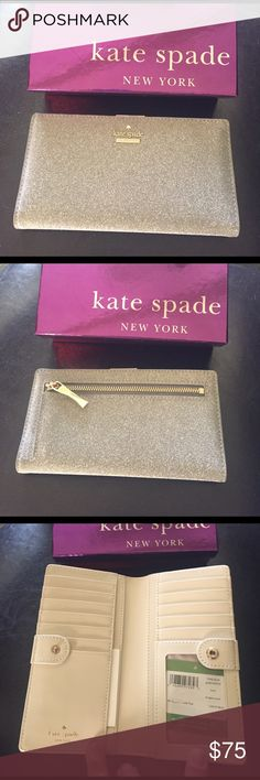 """Kate Spade Stacy Wallet NWT Kate Spade Stacy Burgess Court wallet. Color is Graphite in a glitter finish. Zip pocket on back side   Snap closure opens to 4 bill slots, 13 card slots, and a window id slot. 6.75"""" x 3.5"""". NWT. Comes in a gift box. NO TRADES kate spade Bags Wallets"""