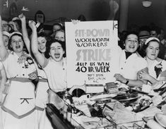 Female employees of Woolworth's holding sign indicating they are striking for a 40 hour work week in 1937.