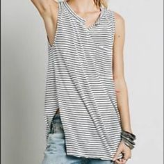 Free People striped pocket tank Free People striped pocket tank. Neckline is a slight v-neck. Sides have a small slit. Stripes are black and white. Worn a few times in great condition. Free People Tops