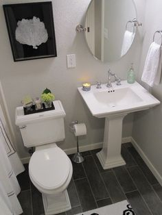 Pedestal sink, floor, mirror, toliet