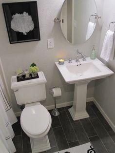 Pedestal sink, floor, mirror, toliet